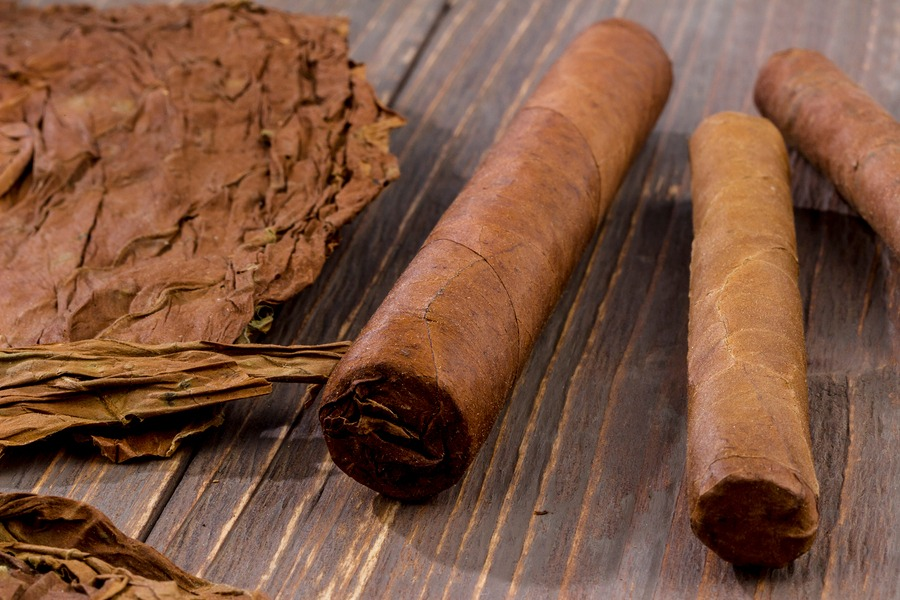 home-cat-02-bigstock-cigars-and-tobacco-leaves-223399603